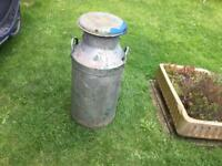 Large old milk churn complete with lid