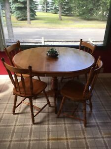 Wooden dinner table and four chairs