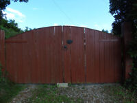 Pair of curved wooden driveway gates