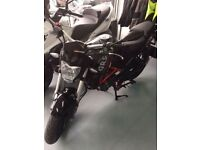 Motorbike in warranty to sell urgently!