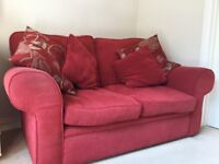 2 Seater Sofa, red, good condition. Includes 4 matching cushions