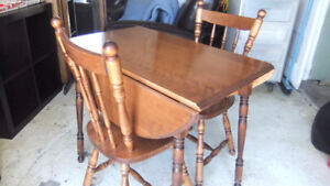 solid maple drop leaf table and 2 matching chairs