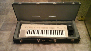 Piano yamaha automatic bass chard system with traveling case