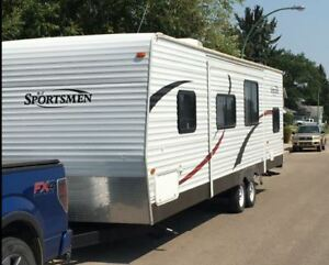 30 ft Sportsmen 314BH, large slide and rear bunk room