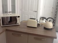 Kettle,toaster and microwave,cream in colour,1 year old,good condition.