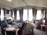 ABI Ambleside Boutique style 5* Platinum caravan to hire on quiet select site with sea views