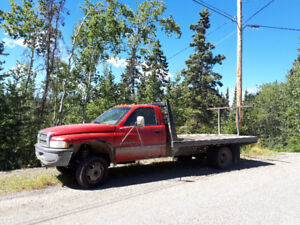1997 Dodge Power Ram 3500 12 foot flat deck dually.
