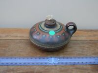 Small pottery oil lamp