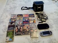 PSP with charger, carrying case and 15 games.