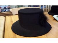 Ladies black hat with wide ribbon and feather detail