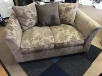 2 seater sofa in a floral fabric