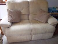 Two X two-seater sofas and puffee.