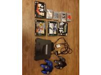 Nintendo 64 console with 2 controllers and 8 quality games