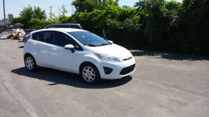 2012 Ford Fiesta hatchback 1.6L ...5000$ non negotiable