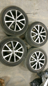 "Volkswagen OEM 16"" 5x112 pattern rims & all season tires"