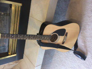 Squier by Fender acoustic guitar with case and strap