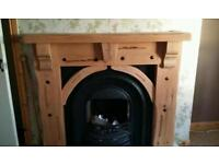 Solid oak fire surround with cast iron inset