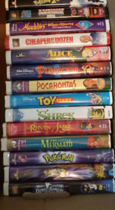 32 vhs movies Includes 14 disney movies clamshell cases See pics