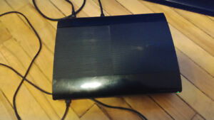 PS3 Slim 500Gb with 2 controllers and 5 games