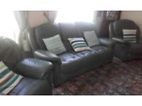 3+1+1 leather suite good clean condition £200. Collection only Portrush