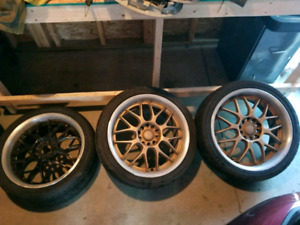 """18"""" after market rims with tires and a set of tires"""