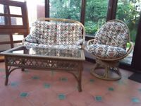 Cane Furniture 2 seater sofa, 2 cane chairs, 1 swivel chair & glass cane table