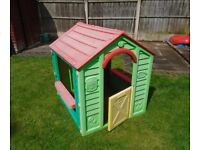 Children's plastic outdoor playhouse.