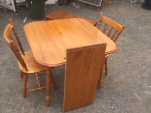 Very solid table with leaf and 2 chairs