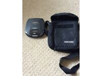 Personal portable CD player and carrier