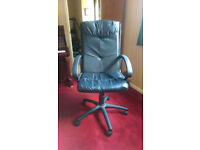 Black leather swivel office chair on casters