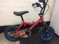 Child's lion bike with stabilisers