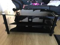 Tv stand ( black tempered glass)