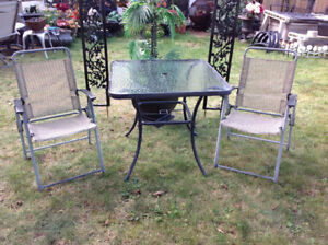 "Set: 36"" round  Glass top table and 2 folding arm chairs"