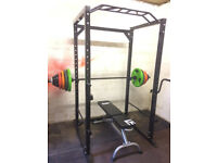Squat rack and Olympic barbell + weights
