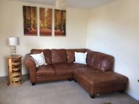 Soft, natural leather corner sofa with storage footstool