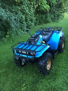 Yamaha moto 4. Includes new winch and tires