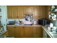 Kitchen cupboards. A selection of Sigma 3 wood kitchen units including appliances and breakfast bar