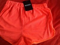 Size 12 MISSGUIDED orange shorts brand New and tagged