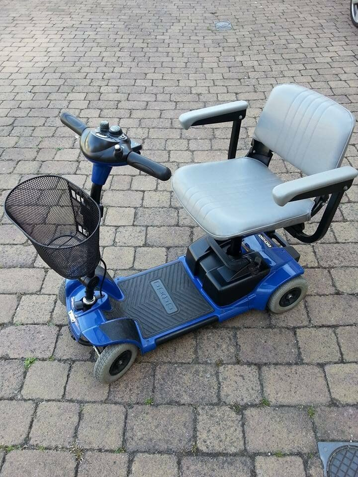 Go-Go Mobility scooter. Good condition. Comes apart to transport.