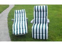 2 almost new reclining deck chairs loungers green & white stripe. not used. cost £100 from Leekes