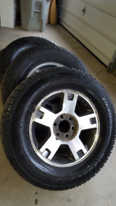 FORD RIMS WITH COOPER TIRES