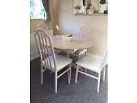 LIGHT WOOD ROUND DINING TABLE AND CHAIRS