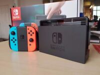 Nintendo Switch (Neon Red and Blue) + ARMS