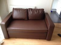 Two seater sofa bed in brown leather in excellent condition £100