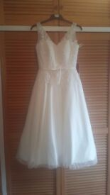 Tea length wedding dress. Never worn.