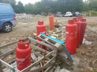 7 Empty gas bottles