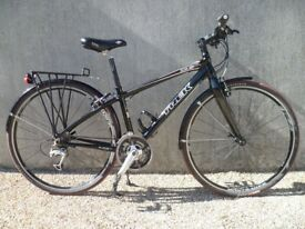 Trek 7.5 FX gloss black hybrid cycle. 15'frame. Excellent condition.