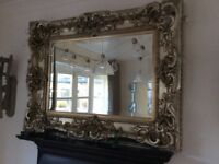 Ornate antique French style gold/silver mirror