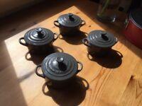 Four Le Creuset petite casserole pots, grey.
