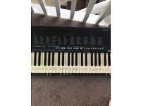 Yamaha psr-18 piano keyboard